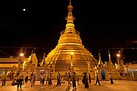 Myanmar, Yangon, Yangon. Night worshippers at the Botataung Pagoda in Yangon in Myanmar.