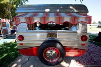 Rear view of Vintage Trailer with red awning, at the 4th Annual Vintage Trailer Bash, Flying Flag RV Resort, Buellton, California