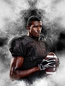 Portrait of an american football player surrounded by fog