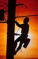 Worker on Power Pole