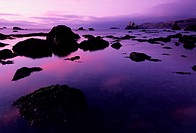 Silhouette of rocks by sea