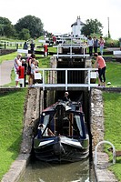 Foxton Locks, lower staircase. Narrowboat emerging from the lower end of Foxton Locks, on the Grand Union Canal, near Market Harborough, Leicestershir...
