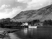A scene on Ullswater, Lake District, Cumbria, England, showing one of the steamers which travel up and down its seven and a half mile length.