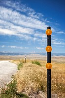 Traffic reflectors along roadside in Wyoming.