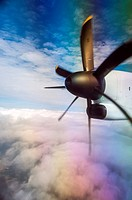A small turbo-prop plane flies through refracted clouds, Ontario, Canada, photographed through the window.