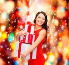 christmas, x-mas, valentine's day, celebration concept - smiling woman in red dress with many gift boxes
