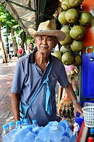 Man selling water bottle on the street.