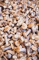 Pile Of Fresh Mushrooms On Market Stall