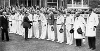 King George V, accompanied by Lord Cromer, President of the M.C.C and Mr. R.E.S Wyatt, the captain, shakes hands with the English cricke players at Lo...