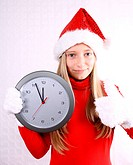 Young girl as Mrs. Santa in red with clock