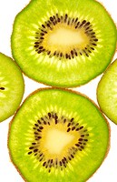 Background of two full and quarters kiwi slices