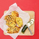 Courgette fritters on paper