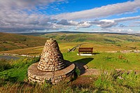 Muker millennium cairn and seat, Thwaite, Swaledale, Yorkshire Dales, England, UK.