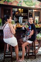 Women sitting at a Juice stand, Fortaleza, Brazil.
