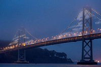 The bay bridge in San Francisco with its LED lights in the fog.