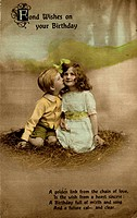 A little girl and boy on a birthday postcard -- he is kissing her on the cheek.