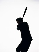 Portrait of businessman swinging a bat, Side View, Silhouette