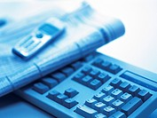 Keyboard, Newspaper and Mobile Phone, Close Up, Blurred, Toned Image