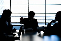 Silhouette Image of a Business Meeting with Three People