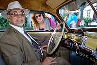 Florida, Miami Beach, Ocean Drive, Art Deco Weekend, festival, street fair, event, antique classic car automobile show, 1941 Chrysler, man, driver, ow...