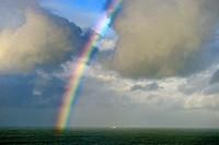 Cargo Ship under the rainbow, Santander, Cantabria, Spain, Europe.