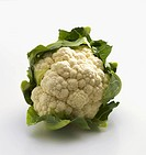 A cauliflower on a white surface