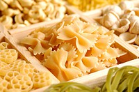 Compartment of farfalle in a box containing a wide variety of different pasta
