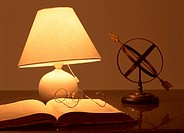 Book and lamp with eyeglasses