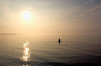 Man Fishing Alone in the Morning