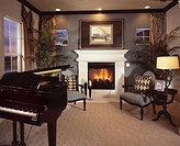 Piano, chairs and fireplace in contemporary house