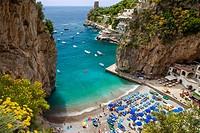 Tiny beach in the rocky coastline of Amalfi near Praiano, Campania Italy.