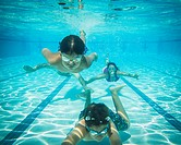Parents and kids (6-12) swimming underwater