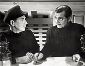 Clark Gable and Richard Haydn in 'Never Let Me Go'. American actor Clark Gable and British actor Richard Haydn acting in the film 'Never Let Me Go'. 1...