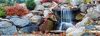 Autumn leaves around waterfall feature