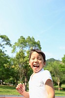 Young Boy Laughing in Park
