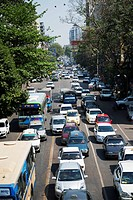 Traffic on a busy road; Rangoon, Burma
