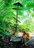 Woman and icons in the forest, Kuz´kino, Russian Federation