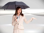 Composite image of elegant businesswoman holding black umbrella