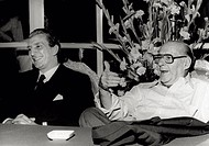 Luigi Vannucchi is cheerfully talking with Roberto Rossellini. Luigi Vannucchi (on the left) and Roberto Rosselliniare cheerfully talking at a table. ...