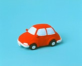 A Clay Red Car on a Blue Background