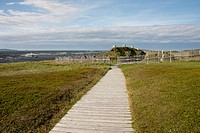 Canada, Newfoundland, L'Anse aux Meadows National Historic Site. Coastal view of park boardwalk to reconstructed open-air museum historic site. UNESCO...