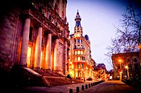 View of central post office building designed by Josep Goday Casals and Jaume Torres Grau at dusk, night. Plaça Antonio López, Barcelona, Catalonia, S...