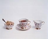 A cup of tea, milk and sugar