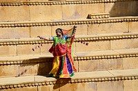 Rajasthani woman dancing on steps in Jaisalmer Rajasthan India MR#704