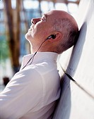 Man with Closed Eyes Listening to Music