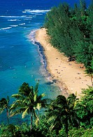 Sunbathers and blue Pacific waters at Ke´e Beach, North Shore, Island of Kauai, Hawaii USA.