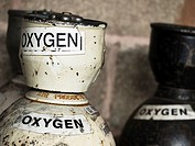 old disused oxygen cylinders, background.