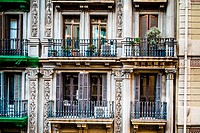 Balconies on Calle Gravina, Barcelona, Spain.