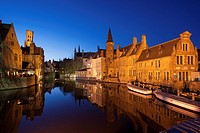 Belfry from the Rozenhoed canal of Bruges reffered as to ´ The Venice of the North ´ pictured at night.