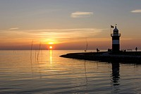 Germany, Lower Saxona, Wremen, North Sea, View of lighthouse at sunset